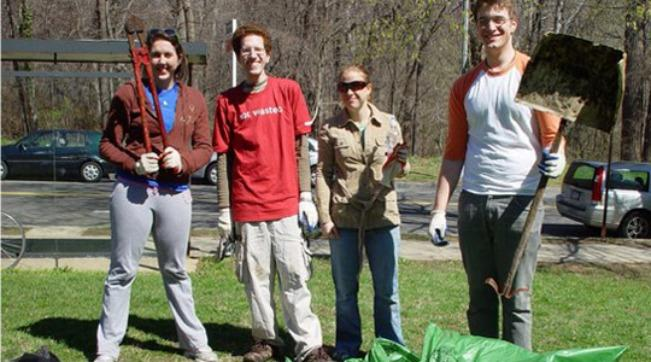 Students volunteering at a tree planting event